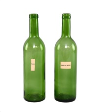green glass wine bottles with printed labels pluie and mer du nord by marcel broodthaers