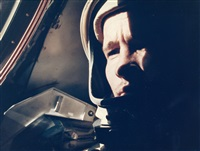 ed white in the pilot's seat of the capsule by james mcdivitt