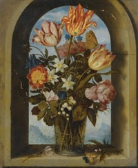 still life of tulips, moss-roses, lily-of-the-valley and other flowers in a glass beaker set in an arched stone window opening, with a distant landscape beyond by ambrosius bosschaert the elder