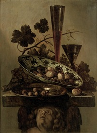 a porcelain bowl with walnuts, a pewter dish with hazelnuts and a 'façon de venise', all on a cherub styled pedestal by abraham susenier