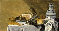 a still life with a ham and a bun on pewter plates, a silver-gilt beaker, a beer glass, a stoneware jug, a knife, bread and a stoneware mustard jar, all on a table draped with a white tablecloth by pieter van berendrecht