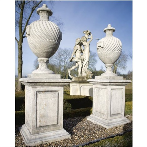 a pair of vases with carved pedestals set of 12 by william kent
