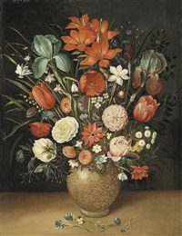 roses, tulips, carnations and other flowers in a vase on a stone ledge by osias beert the elder