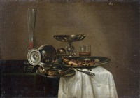 nature morte au pichet, sel et pâté et nature morte au verre de vin et assiette de poisson (pair) by cornelisz mahu