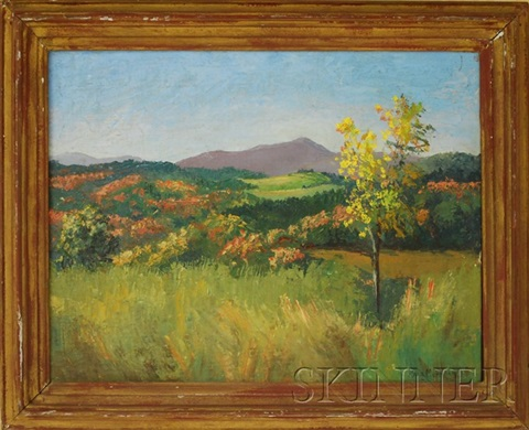 landscape view with fields hills and purple mountains by kyra markham