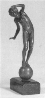 figure of a young boy balancing on a ball by johannes götz