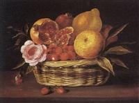naure-morte aux fraises, citrons, roses et grenades dans une corbeille d'oiser sur un entablement by jacques linard