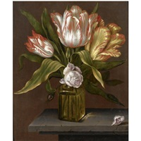 a still life with tulips and roses in a glass vase, on a stone ledge by johannes baers
