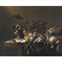 still life with game birds, a plate of oysters, and grapes, all resting on a draped table by michiel simons