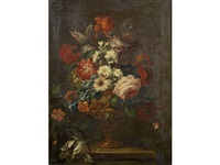 a rose, chrysanthemums, tulips and other flowers in an urn on a stone ledge by gaspar pieter verbrüggen the elder