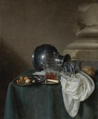 a still life with a pewter jug on its side, a glass of ale, a salt cellar, a bread roll and other objects on a table draped in a dark green cloth by simon luttichuys