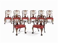 a fine early 20th century george ii style carved mahogany and parcel gilt dining room suite (collab. w/ morant; set of 11) by francis henry lenygon