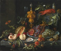 still life of fruits, nuts, oysters, a lobster, insects and a snail on a ledge with various vessels by jan davidsz de heem