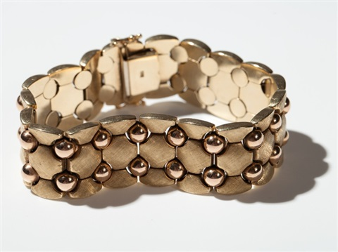 curb chain bracelet of 14 carat rose yellow gold 1960s