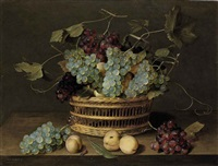 a basket of grapes with peaches, a butterfly, a fly and a beetle on a table by jacob van hulsdonck