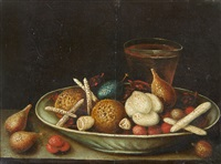 still life with almonds, sweetmeats and drink by georg flegel