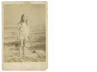 a young girl with bucket and spade at the seaside by lewis (charles lutwidge dodgson) carroll