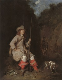 a wooded landscape with a huntsman and his hound by ludolf de jongh