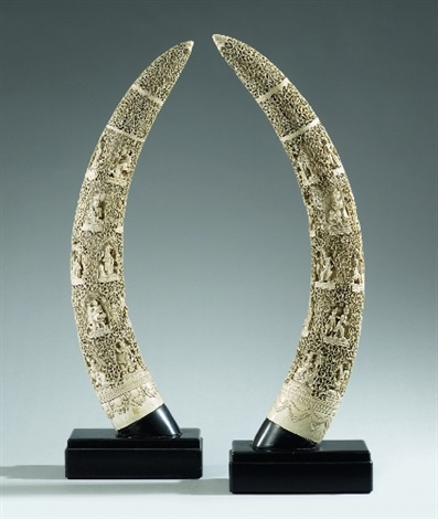 two very large burmese carved elephant's tusks. early 20th century