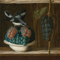 still life of grapes with a gray shrike by antonio (da crevalcore) leonelli