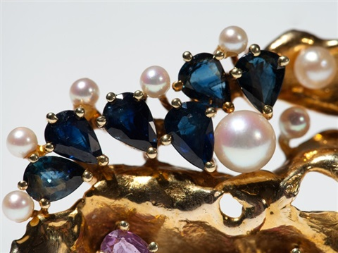 gold brooch of organic shape with gemstones and pearls 1970s