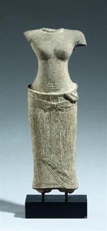 a cambodian female sandstone torso second half 10th century