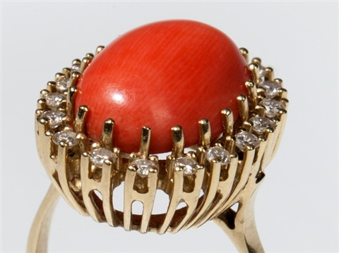 coral cabochon and 18 diamonds in a 14 carat gold ring, 1960s
