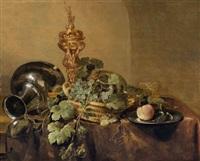 aiguière, plat en étain et panier de raisins sur une table drapée by abraham van beyeren