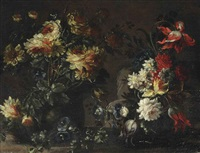 tulips, roses and other flowers in two vases on a ledge by margherita caffi