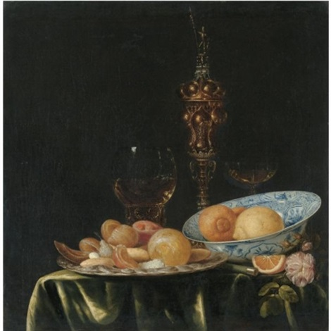 still life with oranges and lemons in a blue and white porcelain dish a large gold pronckblokaal and a silver platter all arranged on a draped table by simon luttichuys