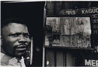 portrait d'un homme à côté d'un petit studio by luis pedro basto