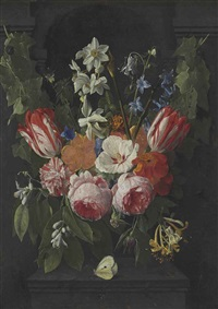 a swag of tulips, peonies, carnations, narcissi and other flowers with a butterfly in a stone niche by nicolaes van veerendael