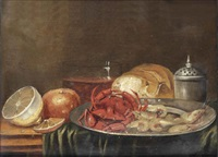 crabs and shrimps on a silver plate, a lemon, an orange, a glass of wine and a loaf of bread, all on a partially draped wooden ledge by alexander adriaenssen the elder
