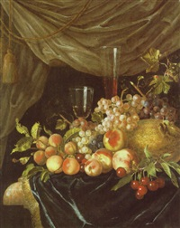 a still life of a glass of wine beside a facon de venise surrounded by grapes, peaches, cherries and melons on a ledge by willem frederik van royen