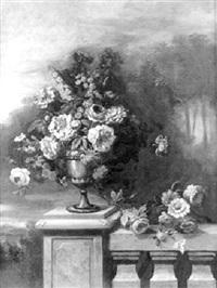 vase de fleurs posé sur une balustrade de pierre by i. s. j. le riche