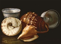three shells and two ceramic bowls by cristoforo munari