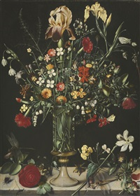 a still life of flowers, including irises, narcissi, lily-of-the-valley and carnations, in a tall glass vase set on a stone ledge by ambrosius bosschaert the elder