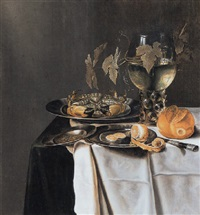 een stilleven met krab en een half geschilde citroen op tinnen borden, een broodje en een roemer, uitgestald op een tafel by pieter van berendrecht
