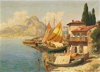 coastal village with fishing boats by gottfried arnegger