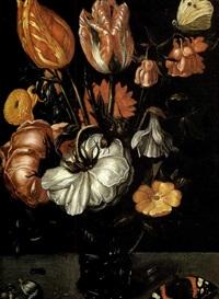 nature morte de tulipes et de roses dans un verre rohmer sur un entablement by jacob woutersz vosmaer