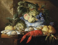 a lobster on a plate, a bread roll, oysters, grapes, a lemon and a porcelain bowl with various fruits, all on a partly draped table by alexander coosemans