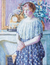 woman before a fireplace by louis ritman