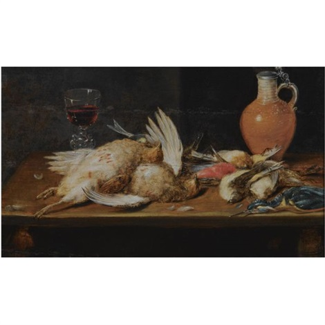 a still life with a robin a kingfisher partridges and songbirds all on a wooden table together with a glass and an earthenware jug by alexander adriaenssen