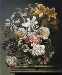 arrangement of peonies and lilies on a marble ledge by bennett oates