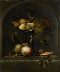 peaches, grapes and a lemon in a silver gilt tazza with peaches, walnuts and an orange in a stone niche by johannes borman