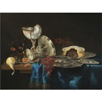 still life with a nautilus cup, a meat pie, a bunch of grapes, some pewter plates and a partly-peeled lemon, all arranged on a partly draped table by gerrit willemsz heda