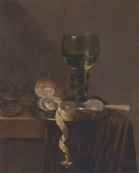 oysters and a partly-peeled lemon on a pewter dish, a roemer, bread and other oysters on a partly-draped table by abraham susenier