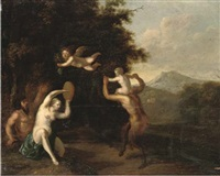 a wooded landscape with satyrs and a nymph dancing by martinus de la court
