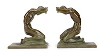 kneeling men: a pair of bookends by isidore konti