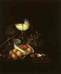 still life of fruit in a wan-li bowl with a nautilus shell and wine glass by nicolaes van gelder